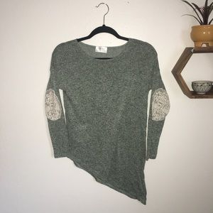 Asymmetrical green top with lace elbow detail